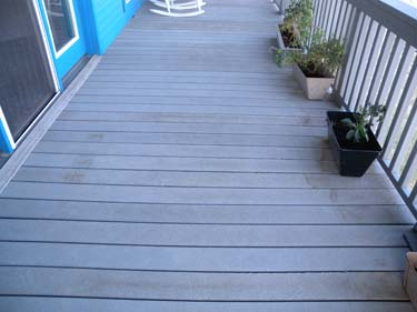 A composite deck marred by stains.